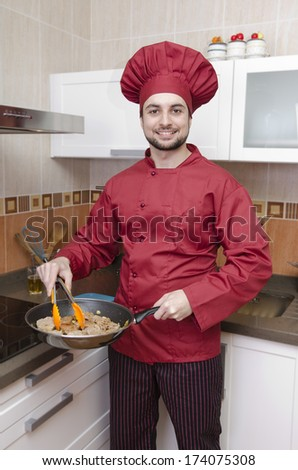The chef in the kitchen. - stock photo
