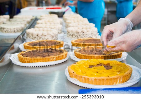 The chef prepares a fruit pie. In the kitchen of the restaurant - stock photo