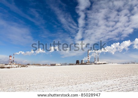 The chemical factory close to power station (winter season) - stock photo