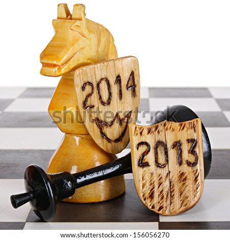 The chess knight the winner as a 2014 year and prostrate king as a 2013 year - stock photo