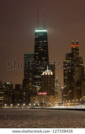 The Chicago skyline centered on the John Hancock Center with a frozen Lake Michigan in the foreground - stock photo