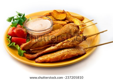 the chicken kebab on skewers with vegetables - stock photo