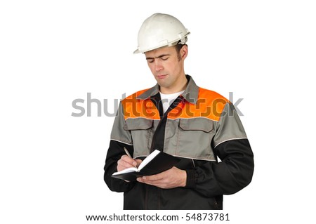 The chief engineer in a helmet writes in a notebook on a white background - stock photo