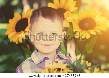 The child, a little boy with blue eyes. Baby smile - stock photo