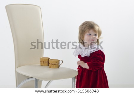 The child, a little girl posing in studio. Carefree childhood. The development and education of preschool children.