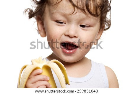 The child eats a banana.