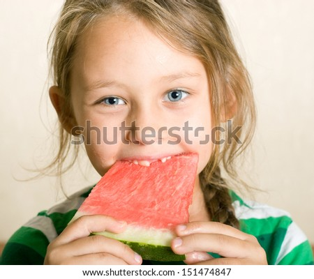 the child eats a juicy watermelon