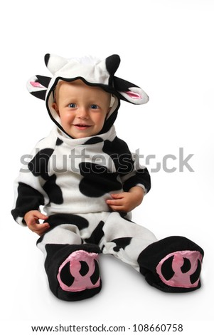 The child in a costume of a cow on a white background - stock photo