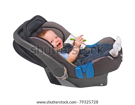 The child in an automobile armchair on the white - stock photo