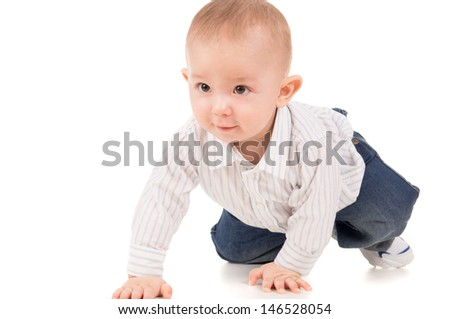 the child in clothes crawling on the floor isolated on white background