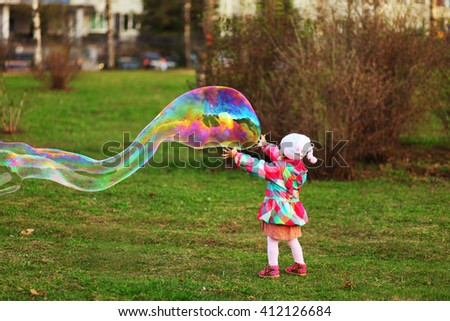 The child in park a outdoors happy. - stock photo