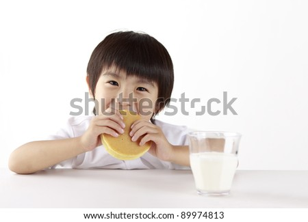 The child is eats a pancake.
