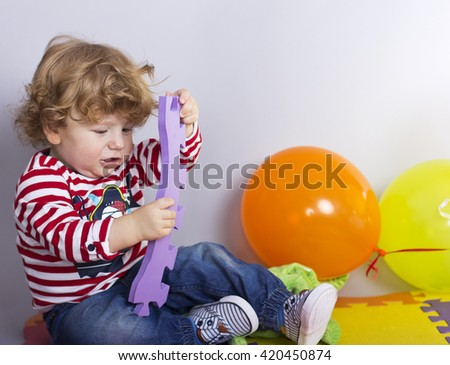 Child one year old toys gifts stock photo 345971528 shutterstock the child is one year old with toys gifts for baby happy boy negle Images