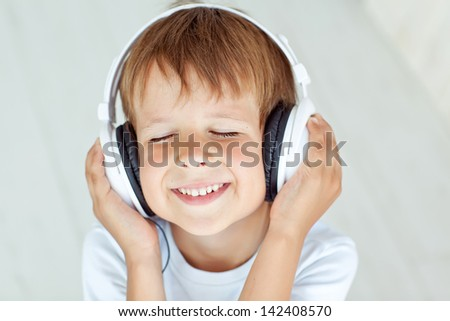 The child listens to music - stock photo