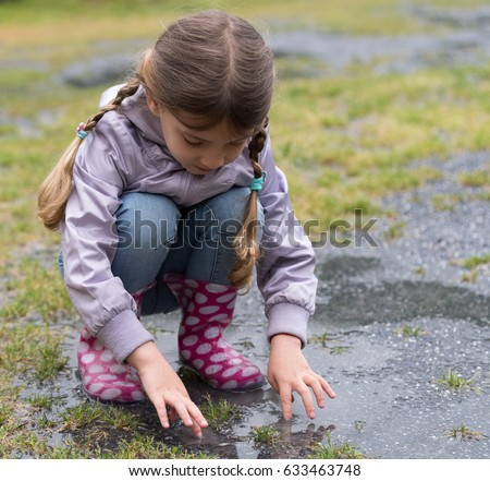 The child playing in a puddle