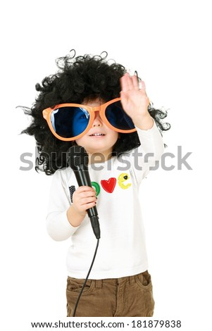 The child sing with wigs - stock photo