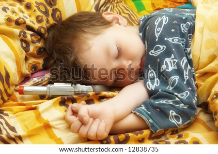 The child sleeps in a bed - stock photo