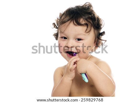 The child study to clean a teeth.  - stock photo