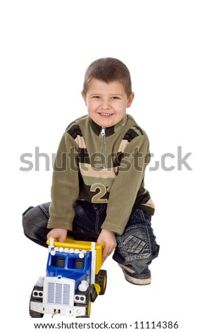 The child with the toy car on a white background