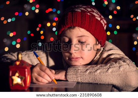 The child writes a letter to Santa Claus. Christmas expectation