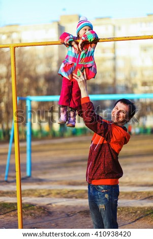 The Children happy outdoors play in playground. - stock photo