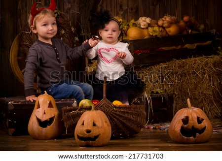 the children on Halloween party with pumpkins