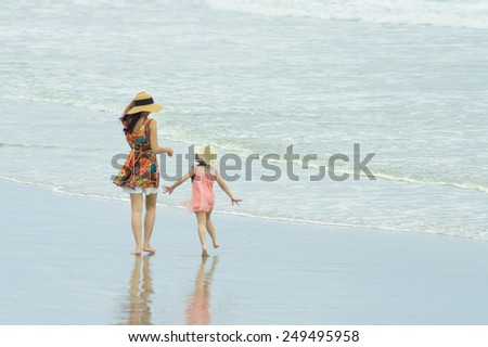 the children playing on the beach in holiday - stock photo