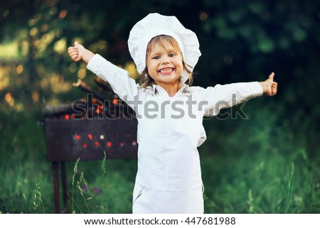 The Children preparing sausages on the coals. - stock photo