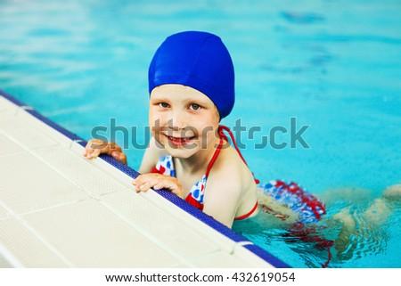 The Children swim in the pool blue. - stock photo