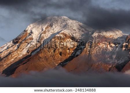 The Chimborazo volcano summit in the morning.  Chimborazo is located in Ecuador near the city of Riobamba. - stock photo