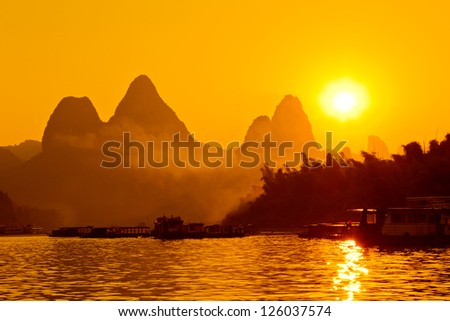 The China Guilin sunset raft - stock photo