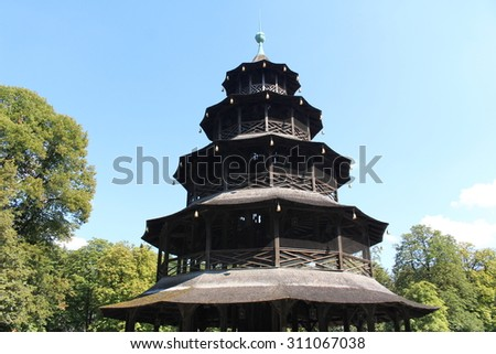 The China Tower (Chinesische Turm or Chinaturm) in the public park English Garden in Munich, Germany. It is a 25 meter high, wood constructed pagoda and it was built in 1789-1790.  - stock photo