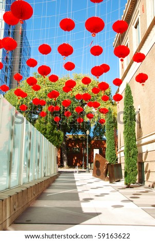The chinese lanterns hang above Fred Meyer Plaza at the front entrance of the Portland Museum of Arts in Portland Oregon. - stock photo