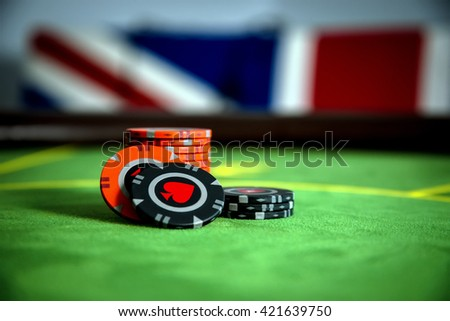 The chips on the poker table - stock photo