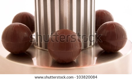 The chocolate candies on the metal  stand