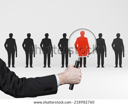 The choice of the best suited employee. Red human sign as a symbol of chosen one by the recruiter. HR, HRM, HRD ,CRM concepts.  - stock photo