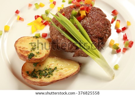 The chopped steak with baked potato