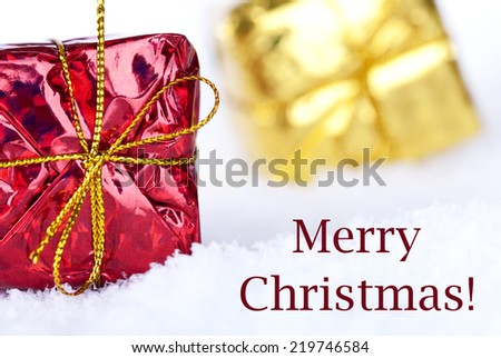 The Christmas Greetings Merry Christmas in the Snow with Christmas Gifts - stock photo