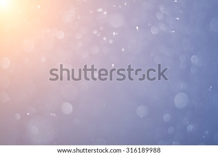 the christmas snowfall at sunset - stock photo