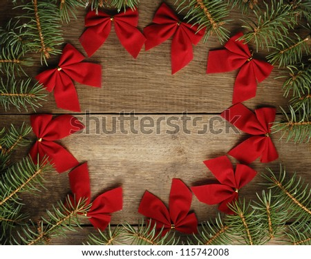 The Christmas Wreath on the wooden background - stock photo