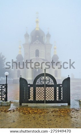 The Church of Christ's Resurrection within a cloud. It is located on 400-meter Red Cliff over the Black sea near Baidarsky Pass. Crimean mountains. - stock photo