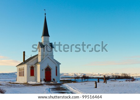 The church of Nesseby, Norway, one of the northernmost of Europe - stock photo