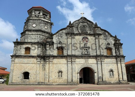 The Church of Santa Monica, the first church built on Panay, Philippines, was constructed in 1774 under the Spanish. It is a national historic site and home of the biggest bronze church bell in Asia. - stock photo