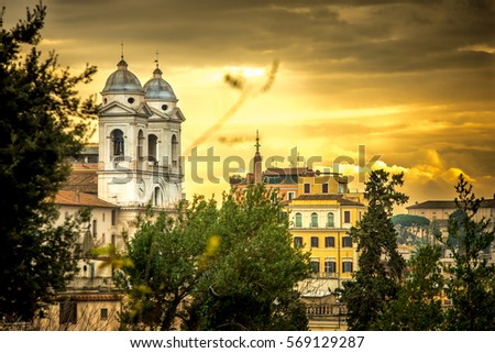 The church of the Santissima Trinita dei Monti and Spanish Steps on a sunrise. Rome. Italy