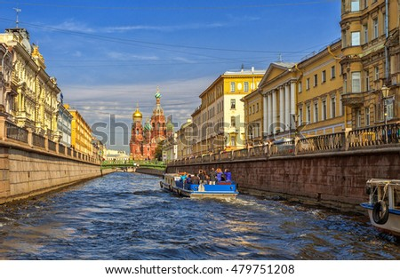 The Church of the Savior on Spilled Blood and historic homes along the canal Griboyedov of St. Petersburg, Russia.