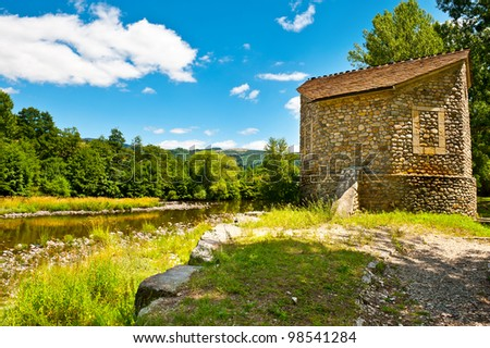 The Church on the Shore of River in the French Alps