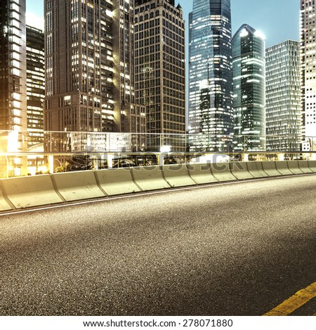 The city and the road in the modern office building background - stock photo
