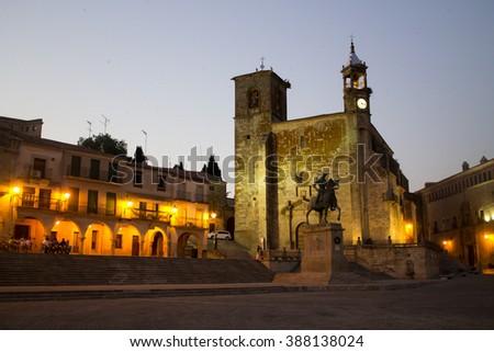 The city center of Trujillo with San Martin Church and the equestrian statue of Francisco Pizarro in Plaza Mayor. Extremadura, Spain - stock photo