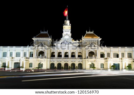 The city hall of Ho chi minh, capital of vietnam with streak of traffic lights - stock photo