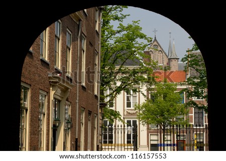 The city Leiden in the Netherlands seen from beneath an arch